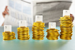 STOCK word on graph like coin stacks Stock Photo
