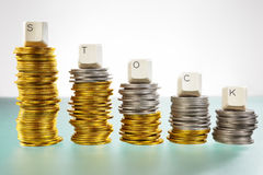 STOCK word on graph like coin stacks Royalty Free Stock Image