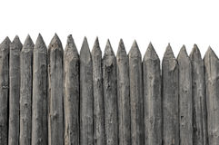Stockade. Fence out of old logs. Vintage protective structure. Medieval fencing Stock Image
