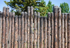 Stockade Fence. An old style stockade fence made from lodge pole pine logs Stock Photo