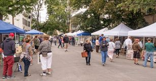 Stockade Villagers Outdoor Art Show. People attending and viewing Stockade Villagers Outdoor Art Show In the Stockade Historic District section of Schenectady royalty free stock photo