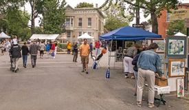 Stockade Villagers Outdoor Art Show. People attending and viewing Stockade Villagers Outdoor Art Show In the Stockade Historic District section of Schenectady stock photography
