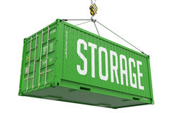 Stockage - récipient de cargaison accrochant vert photos stock