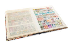 Stockbook med portostämpelsamlingen Arkivbild