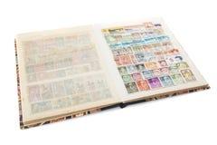 Stockbook mit Briefmarkesammlung Stockfotografie