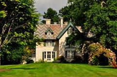 Stockbridge, MA: Linwood Cottage. Stockbridge, Massachusetts - September 16, 2014: 19th century Linwood House surrounded by trees and flowering Hydrangeas at the Stock Image
