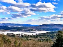 Stockbridge winter view. From hill with blue sky and white clouds in massachusetts United States stock image