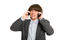 Stockbroker talking on two mobile Stock Images