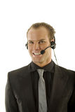 Stockbroker wearing headphones Royalty Free Stock Images