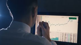 Stockbroker is working on global financial trading growth analysis strategy at computer. Stockbroker is working on global financial trading growth analysis stock footage