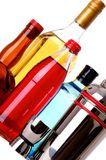 Stocked Bar. Several bottles of liquor that are fun and colorful with bar utensils stock image