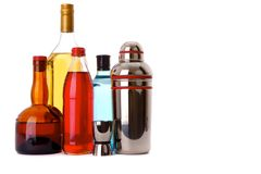 Stocked Bar. Several bottles of liquor that are fun and colorful with bar utensils Stock Photography