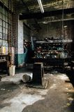 Stocked and Grimy Machine Shop - Abandoned Glass Factory. A stocked machine shop inside an abandoned glass manufacturing company, since demolished Royalty Free Stock Image