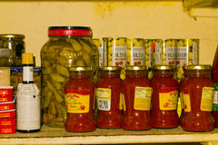 A stocked shelf at mac's pizzeria, bequia Royalty Free Stock Photos