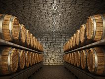 Stocked wine barrels across two sides of corridor of a wine cellar Royalty Free Stock Images