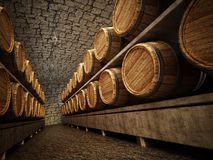 Stocked wine barrels across two sides of corridor of a wine cellar Royalty Free Stock Photography