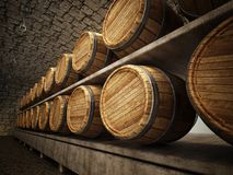 Stocked wine barrels across two sides of corridor of a wine cellar Royalty Free Stock Photos