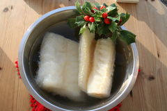 Stockfish - Lutfisk- Swedish dish for Christmas. Stockfish in water to be ready for preparing until Christmas dinner Royalty Free Stock Images