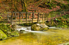 Stockghyll bridge. Wooden bridge crossing stockghyll beck in Ambleside, Cumbria Royalty Free Stock Photography