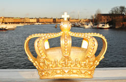 Stockholm. Architectural detail of bridge in Stockholm with golden crown, the symbol of Swedish monarchy Royalty Free Stock Images
