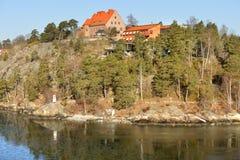 Stockholm archipelago. Houses on rocky island Stock Photos