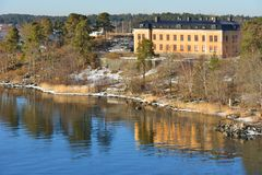 Stockholm archipelago. Old yellow house on rocky island. Spring. In Sweden Stock Image
