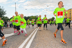 STOCKHOLM - AUG, 17: Groups for children running by in the Midni Royalty Free Stock Photos