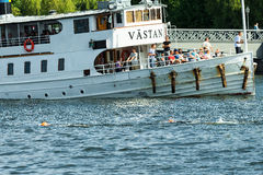 STOCKHOLM - AUG, 24: Two triathletes warming up passing a passen Stock Photography