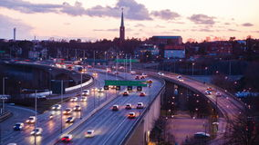 Stockholm city at dusk. Traffic on Freeway in Stockholm at dusk stock video footage
