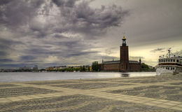 Stockholm City hall. Clouds over Stockholm City hall stock image
