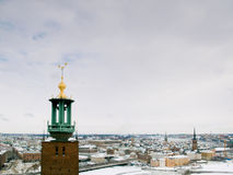 Stockholm city hall. The famous tower of Stockholm City Hall in front of downtown Stockholm and the old town Stock Photos
