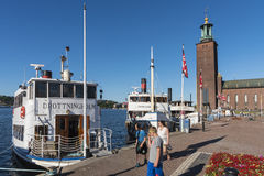 Stockholm City Hall and moored passengerboats Stock Photography