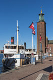Stockholm City Hall and moored passengerboats Stock Photos
