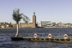 Stockholm City Hall. With a Palm Tree and Three Buoys Stock Image