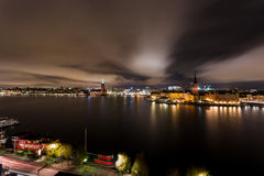 Stockholm City Hall and Riddarholmen by night Royalty Free Stock Images
