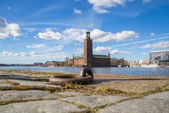 Stockholm City Hall (Stadshuset) at Midday. City Hall of Stockholm Against a Blue Cloudy Midday Sun Royalty Free Stock Photography