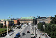 Stockholm city. Scenic view of buildings in Stockholm city with cars on straight road in foreground, Sweden Stock Image
