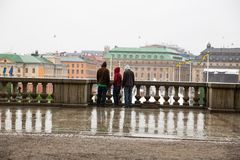 Stockholm city. Stockholm, Sweden - August 11, 2014 - City view from the Royal Palace, rainy day, young people looking down Stock Photos
