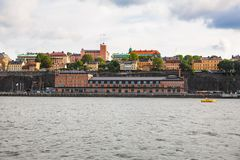 Stockholm city view. Stockholm, Sweden - August 11, 2014- Sodermalm island view from sea Royalty Free Stock Photos