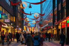 STOCKHOLM - DEC 19: Drottninggatan during christmas and rushhour Stock Photos