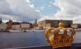 Stockholm, Gamla Stan. Sweden, Stockholm, A golden crown on the bridge to Skeppsholmen with a view to the historic centre Gamla Stan Royalty Free Stock Photos