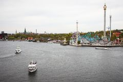Stockholm harbor with boats and luna-park Stock Photography