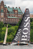 STOCKHOLM - JUNE, 30: Sailboat HUGO BOSS in a faceoff with sailb Royalty Free Stock Photos