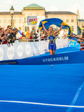 Stockholm - Lisa Nordén at the finishline - ITU World Triathlon. STOCKHOLM - Aug, 24: Lisa Norden running to the finishline with a swedish flag and she was the Stock Photos