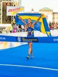 Stockholm - Lisa Nordén at the finishline, Swedish flag, Crying. STOCKHOLM - Aug, 24: Lisa Norden crossing the finish line with a swedish flag, winner of the Stock Photography