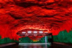 Stockholm metro or tunnelbana station Solna Centrum with fire li. Stockholm underground metro or tunnelbana station Solna Centrum with fire like wall designs royalty free stock image