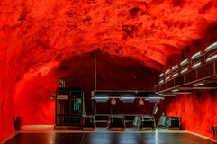 Stockholm metro or tunnelbana station Solna Centrum with fire li. Stockholm underground metro or tunnelbana station Solna Centrum with fire like wall designs stock image