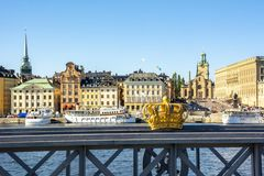 Stockholm old town Gamla Stan cityscape and Royal crown, Sweden stock photos