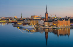 Stockholm Old Town reflected over frozen water at dawn. Stockholm Old Town reflected over frozen water at dawn on a cold winter day Royalty Free Stock Photos