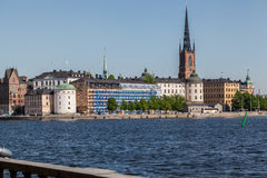 Stockholm Riddarholmen Church. The historical buildings, the long tower of Riddarholmen  at the shore of Ridarfjarden,  Stockholm, Sweden Royalty Free Stock Image